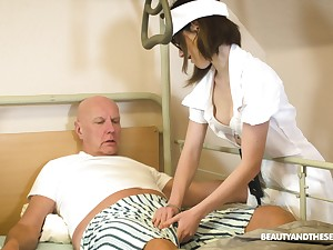 Teen nurse with glasses Adelle Sabelle gives a wonderful blowjob to senior citizen