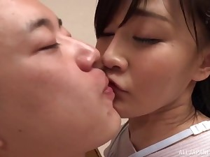 Japanese hottie pleasures the brush defy with a handjob in the kitchen